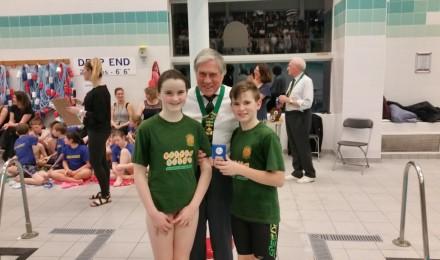 Eleanor & Evan receiving St Matthew's team trophy